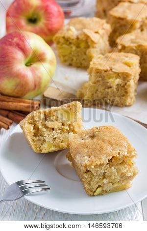 Homemade blondie (blonde) brownies apple cake square slices on plate vertical
