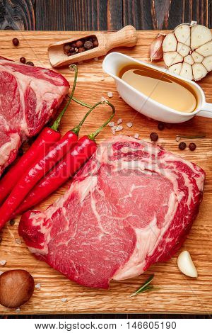 Uncooked organic shin of beef meat on cutting board
