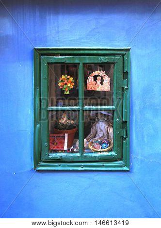 Vintage window in small medieval house on Golden Lane (Zlata Ulicka), Prague.