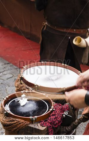 street musician playing the drums with sticks