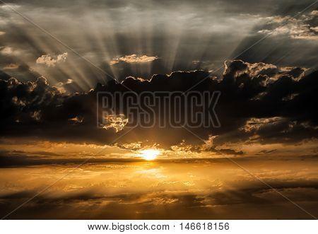 Sunrays Dramatic sky as the sun hides behind a black cloud.