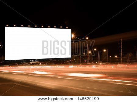 blank billboard on the highway blank billboard during the twilight light blank billboard in city background. With clipping path on screen.- can be used for display your products or promotional.