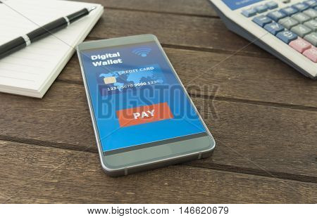 Digital wallet in your smartphone is placed on a wooden table. Business concepts and technology.