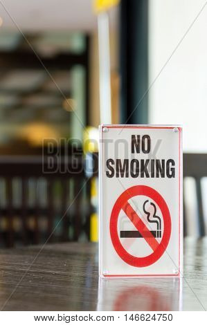 Signs of non smoking in restaurant .