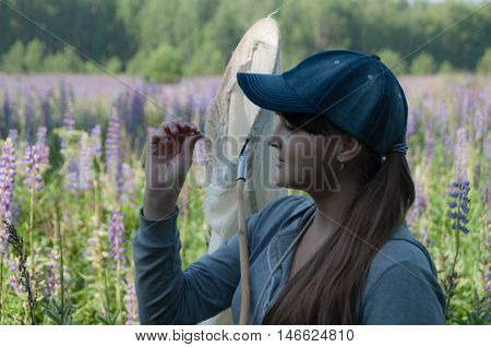 girl entomologist studying insects in nets at forest background