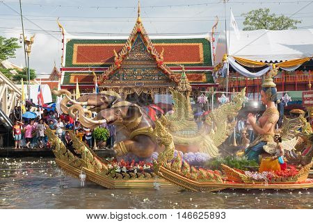 SAMUT PRAKAN,THAILAND - OCTOBER 3,2009 : people enjoy the Lotus throwing procession by the river ceremony on End of Buddhist Lent Day in Rub Bua Festival ,Samut Prakan Province, Middle of Thailand.