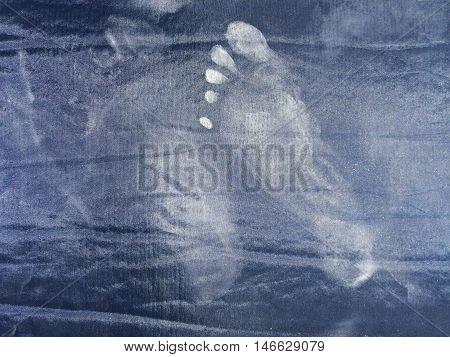 Dusty footprint on dark tent mattress texture