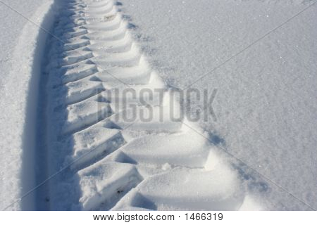 Tractor Or Truck Tracks In The Snow