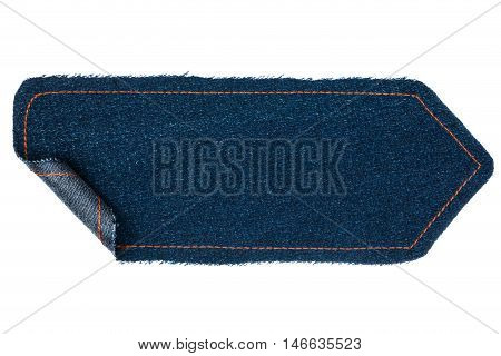 Arrow made from a denim with wrapped edges isolated on a white background.
