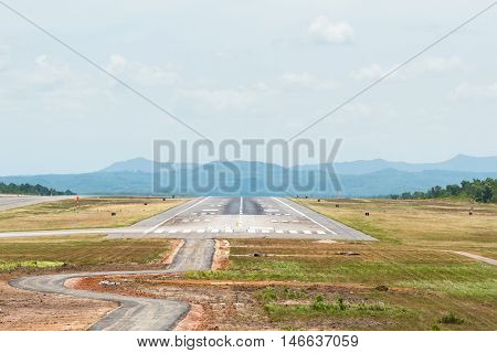 Airport Runway with sky and slouds in summer day.