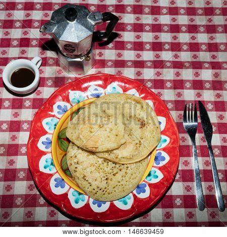 Italian brakfast with homemade pancakes neapolitan coffee and maple syrup