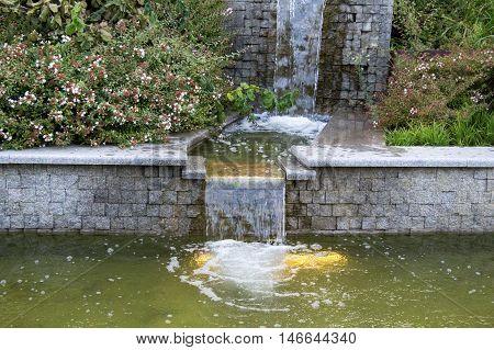 Water flows through the granite steps. Summer Park