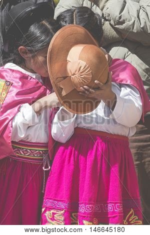 Puno, Peru - August 20, 2016: Native People From Peruvian City Dressed In Colorful Clothing Perform