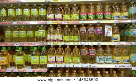 Cooking Oil Stacked Vertically In Store Shelf