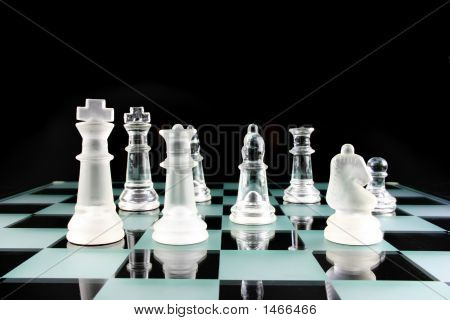 Chess Pieces On A Glass Board