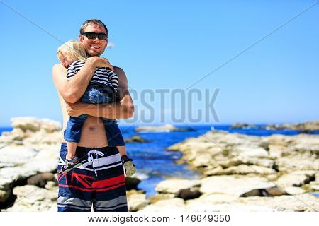 Young Father With Little Daughter On Rocky Coast At Kaikoura Peninsula