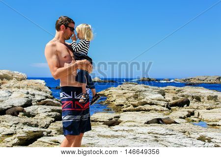 Young Father With His Daughter On Rocky Coast At Kaikoura Peninsula