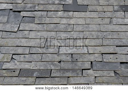 Esteville France - june 23 2016 : damaged slate roof