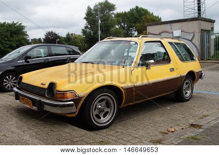 Almere, The Netherlands - September 11 2016: Yellow AMC Pacer Wagon on a public parking lot in the city of Almere. Nobody in the vehicle.