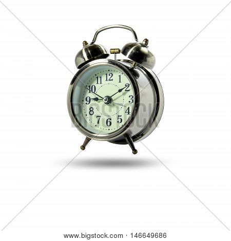 Vintage analog alarm clock isolated on white background.