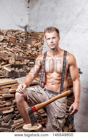 Shirtless Lumberjack With An Axe