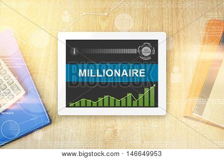 millionaire word on tablet with soft light vintage effect