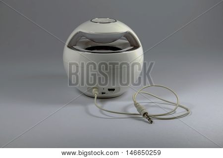 Portable speaker for computer notebook and smart phone isolated on gray background.