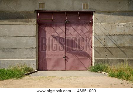 Warehouse. Closed warehouse doors. Warehouse metal door