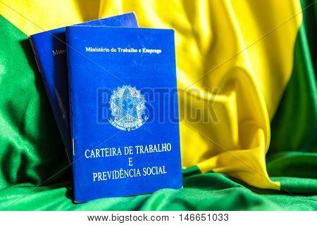 Brazilian document work and social security (Carteira de Trabalho e Previdencia Social) on the flag of Brazil