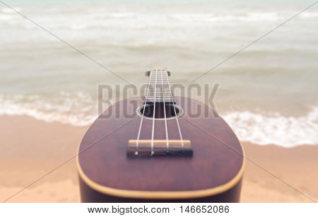 ukulele with beach background music concept abstract