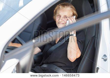 Elderly Woman Behind The Steering Wheel