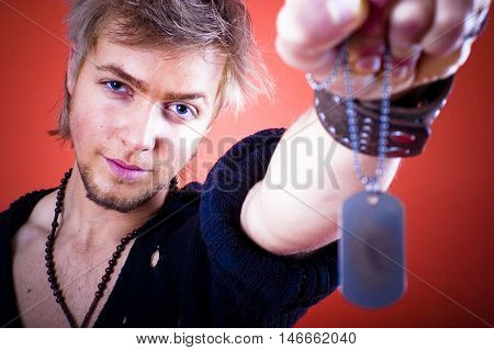 Guy Holding Id Tags