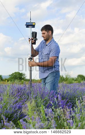 Geodesy work in a lavender field in countryside