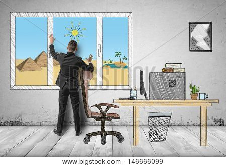 Businessman standing in his office in front of the window with pyramids and sands behind it. Dreaming of vacation. Leave of absence, holiday.
