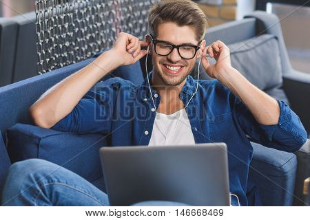 pure happiness, man touching his headphones while listening to music