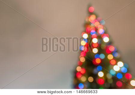 Defocused christmas tree silhouette with blurred lights