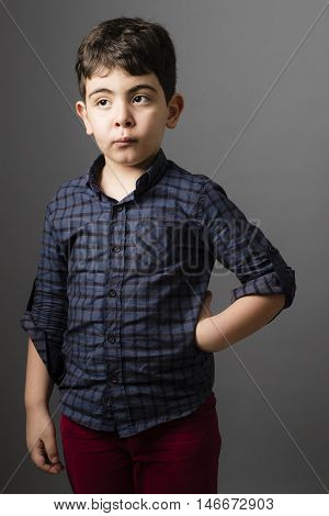 Small boy Standing inside Studio isolated on grey background