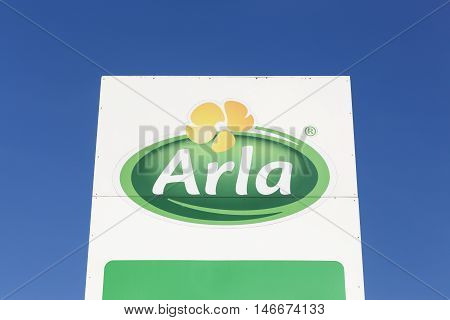 Taulov, Denmark - September 10, 2015: Arla Foods logo on a panel. Arla Foods is an international cooperative based in Aarhus, Denmark, and the largest producer of dairy products in Scandinavia