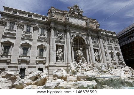 Rome, Italy: The Trevi Fountain Italian: Fontana di Trevi. It is designed by Italian architect Nicola Salvi and completed by Pietro Bracci. The largest baroque fountain in the city.