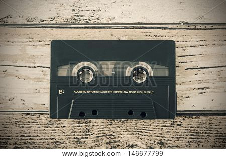 Old casette tape from top view composition. Retro styled photo.