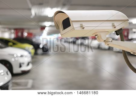 CCTV camera digital video recorder in car park for Security of place.