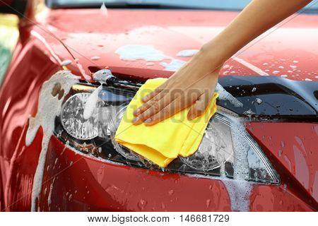 Servicewoman washing a car
