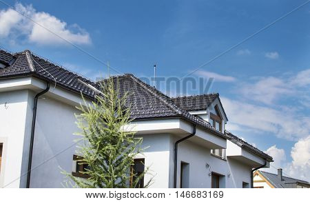 The House With A Roof Of Roof Tile