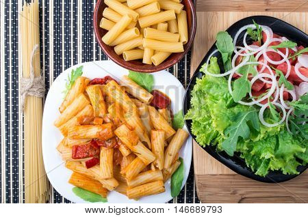 Top View Of Cooked Rigatoni Pasta With Vegetable Sauce