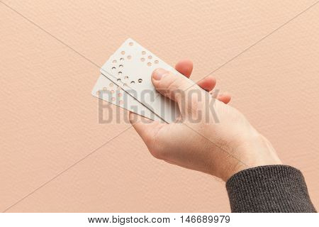 Male Hand Holds Plastic Door Key Cards