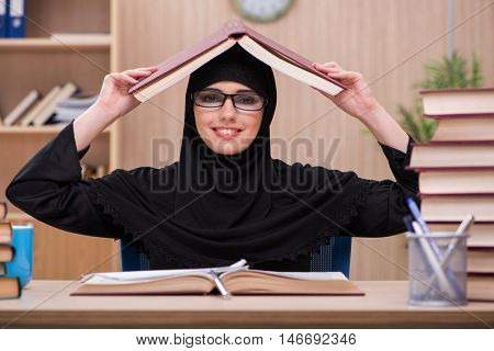 Woman muslim student preparing for exams