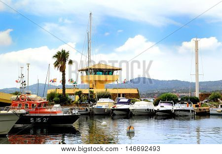 Le Lavandou, Provence, France - August 17 2016: Harbourmaster Building And Lifeboat In The Harbor At