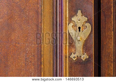 Part retro wooden cabinet with brass fittings, texture and background