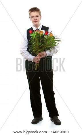 The pupil of the senior classes in a school uniform with a bouquet of flowers