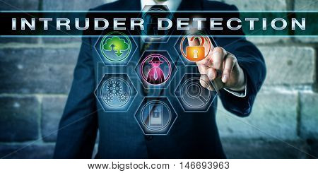 Security manager is pressing INTRUDER DETECTION on an interactive command screen. Concept for computer and information security procedure aimed at identifying a unauthorized network intruder.